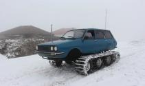 Hafta sonları en büyük eğlencesi paletli Toros'u ile karla kaplı yaylayı gezmek