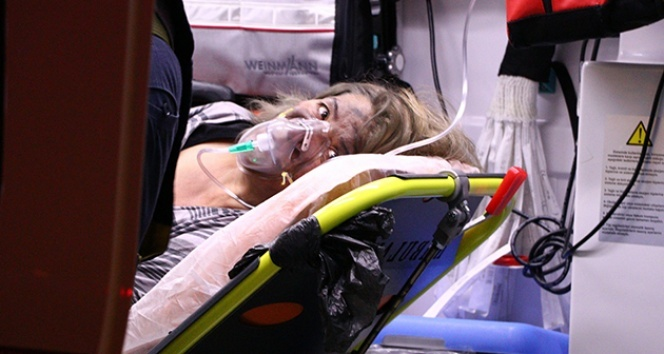 Alevlerin arasında kalan kadın balkondan atladı