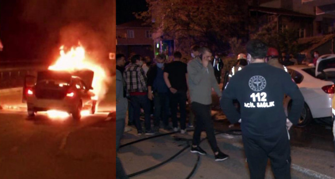 Ataşehir'de tam kapanmayı unutan vatandaşlar alev alev yanan lüks aracı film izler gibi izledi