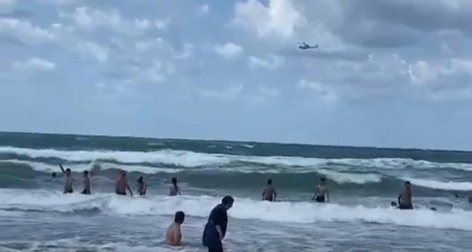 Şilede yasağı hiçe sayan vatandaşlar denize girmeye devam etti