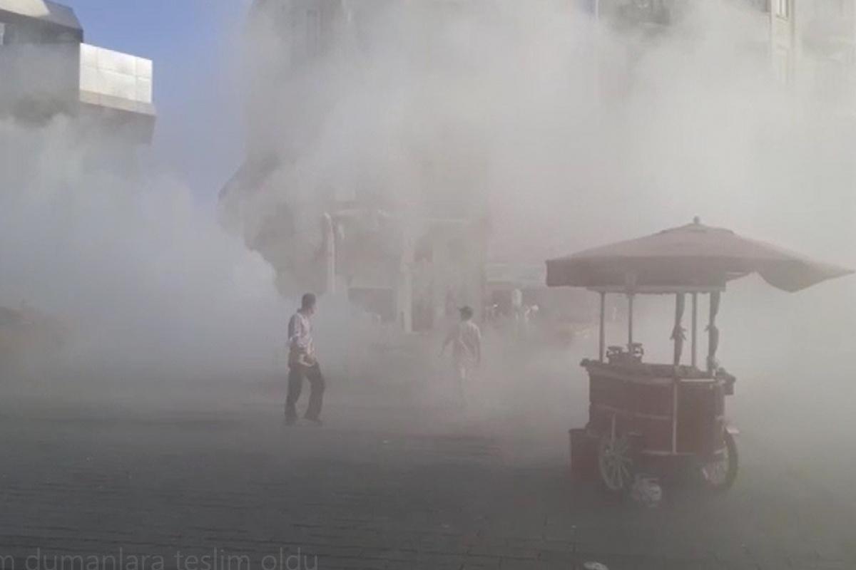 Taksim'de taksiden çıkan dumanlar tüm meydanı sardı