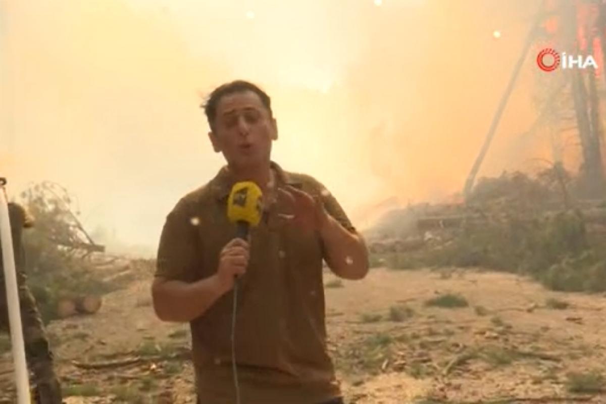 Azerbaycanlı muhabir ve kameraman alevlerin arasında kalmaktan son anda kurtuldu