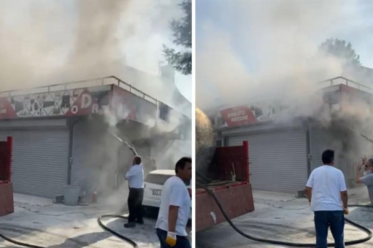 İş yerinde çıkan yangını hortum ve yangın tüpleri ile söndürmeye çalıştılar